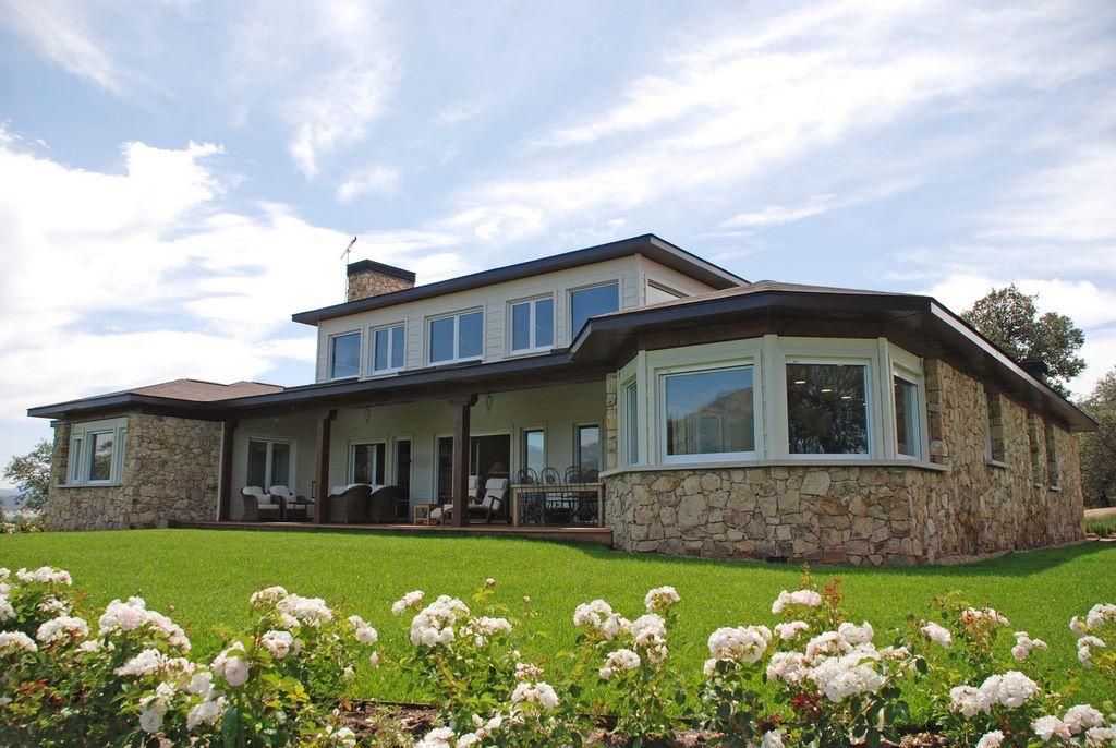 Casa north bay canexel for Casas de piedra y madera
