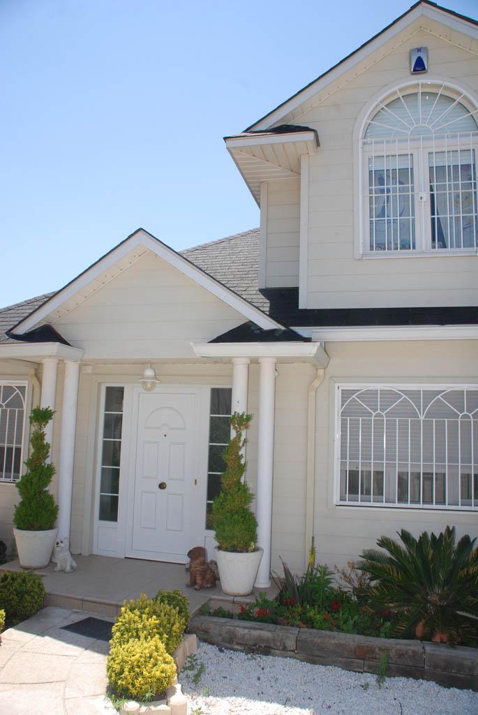 Casa berwick canexel for Casas estilo americano