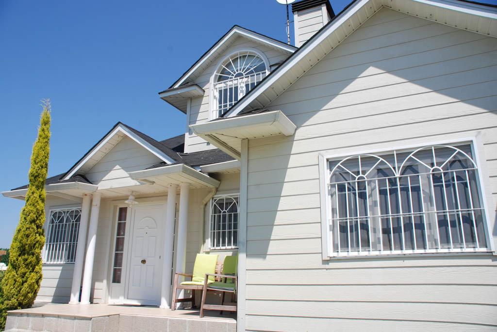 Casas prefabricadas madera casas de madera estilo canadiense for Canexel construcciones