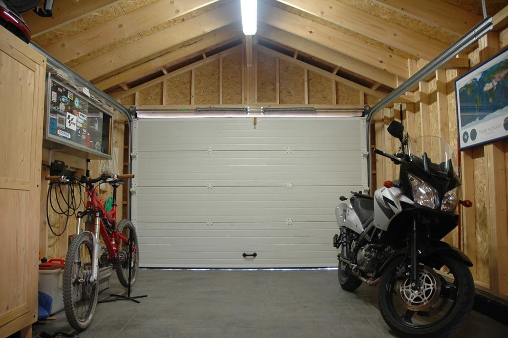 Exteriorismo con madera for Tipos de garajes