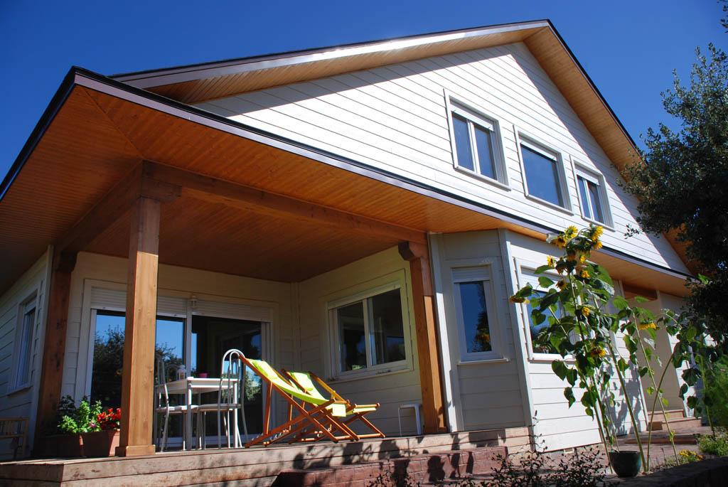 Casa whitehorse canexel - Casas con porches de madera ...