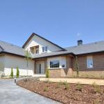 Entrada a la casa - Edmonton, casas de madera