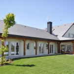 Fachada Jardín - Edmonton, casa de madera