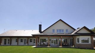 Fachada trasera - Edmonton, casas de madera