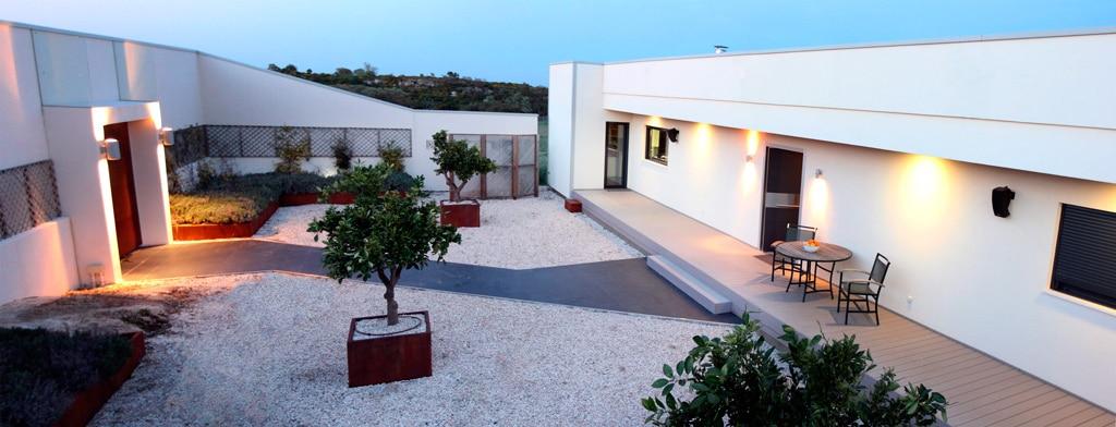 Casa corten h canexel for Casas de madera para patios